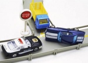 Toy cars at a stop sign