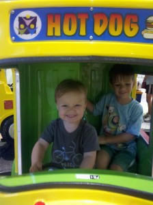 The boys, driving a hot dog truck
