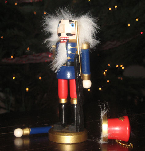 Nutcracker, missing an arm and his hat