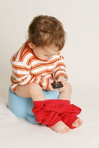 potty training boy on potty with phone