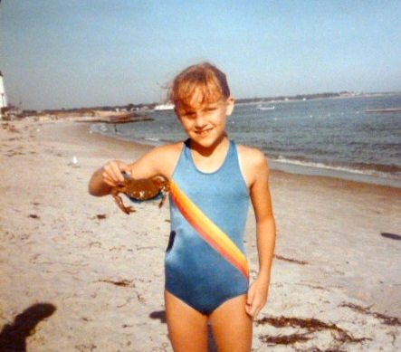 Abby holding a crab, 1980-something