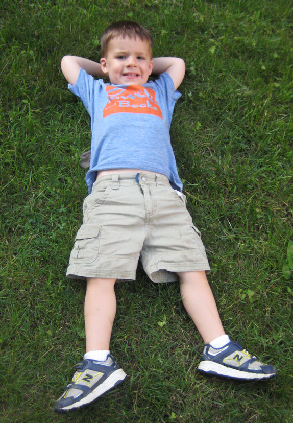 Miles, age 3, relaxing on the grass
