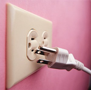 Unplugged, plug on a pink wall