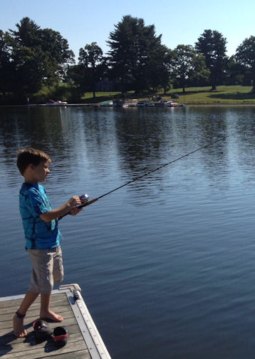 Miles fishing from the dock