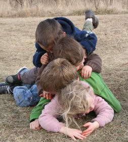kids pig-piled on top of each other