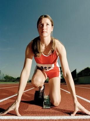 female track runner on her mark