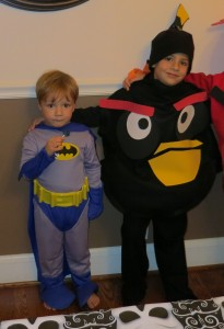Batman and an Angry Bird dressed up for Halloween