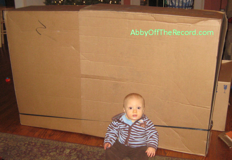 Baby and giant flatscreen TV box