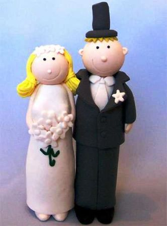 Bride and groom clay cake-topper