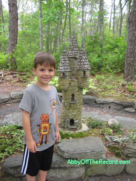 my son at a fairy garden in Cape Cod