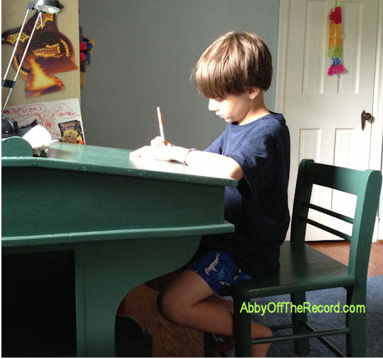 boy drawing at his desk