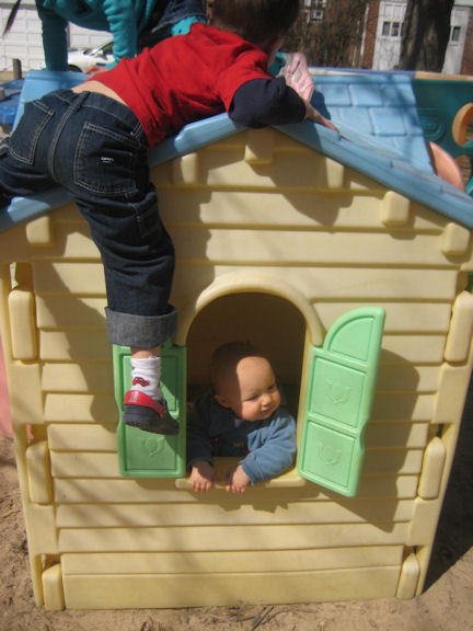 boys climbing on a playhouse
