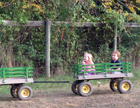2 kids on a tractor ride