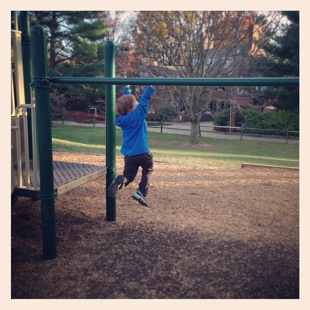 boy on the monkey bars