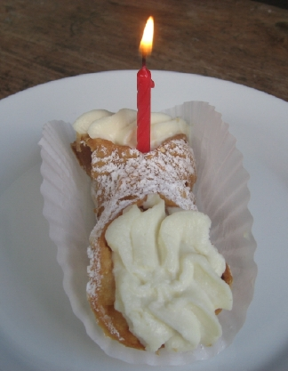 birthday cannoli with a candle in it