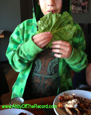 kid eating a huge lettuce leaf