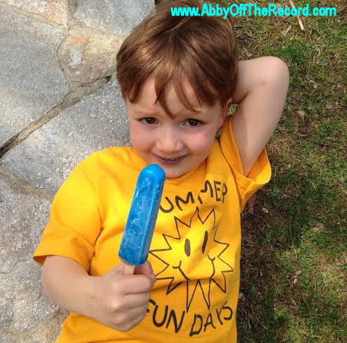 boy enjoying a blue popsicle