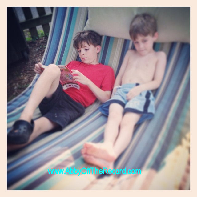 boys on a hammock, reading