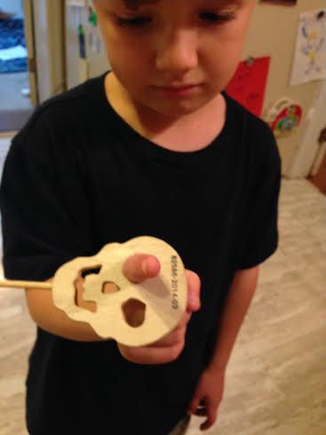 boy with finger stuck in Halloween decoration