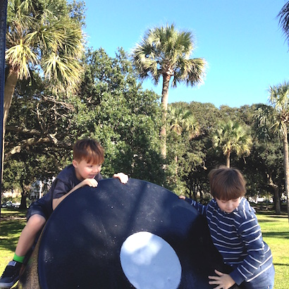 Boys climbing on a cannon at the Battery in Charleston