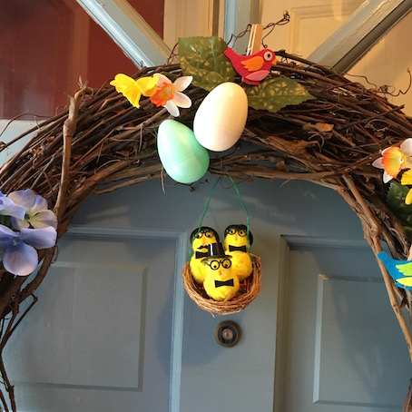 Spring wreath featuring plastic eggs and yellow chicks
