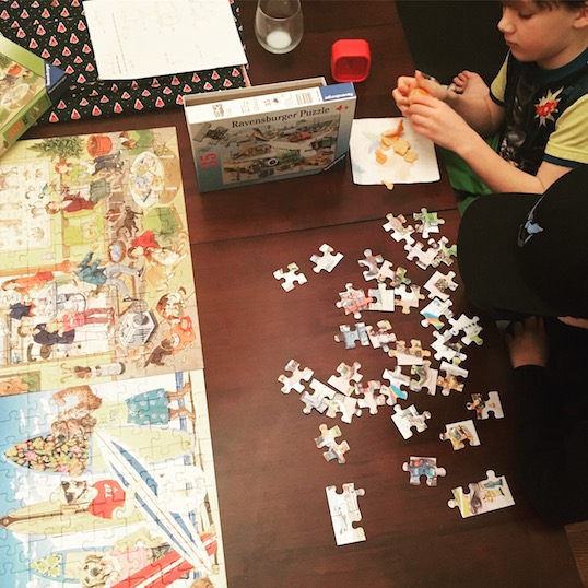 boys doing jigsaw puzzles